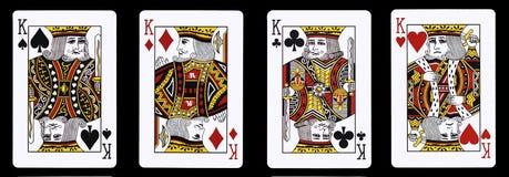 4 βασιλιάδες σε μια σειρά - κάρτες παιχνιδιού Στοκ φωτογραφία με δικαίωμα ελεύθερης χρήσης