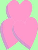 Βαλμένες σε στρώσεις καρδιές σε ανοικτό πράσινο Στοκ Εικόνες