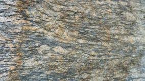 Βαλμένο σε στρώσεις Gneiss πέτρινο υπόβαθρο σύστασης Στοκ Εικόνες