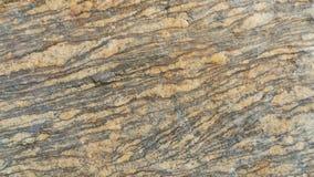 Βαλμένο σε στρώσεις Gneiss πέτρινο υπόβαθρο σύστασης Στοκ Φωτογραφίες