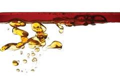 Βενζίνη στο νερό που απομονώνεται στοκ φωτογραφίες
