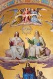 Βιέννη - ιερή τριάδα. Λεπτομέρεια από τη νωπογραφία της σκηνής από την αποκάλυψη από. το σεντ 19. κύριο apse της εκκλησίας Altlerc Στοκ εικόνα με δικαίωμα ελεύθερης χρήσης