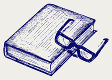 Βιβλίο και γυαλιά απεικόνιση αποθεμάτων