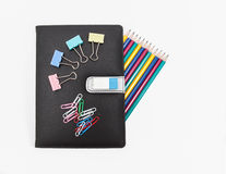 Βιβλίο σημειώσεων και χαρτικά Στοκ Φωτογραφίες