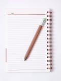 Βιβλίο σημειώσεων με το μολύβι,   Στοκ Εικόνες