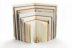 Βιβλία με επεκταθείσα μορφή με ένα κουδούνι Στοκ Φωτογραφία