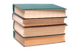 βιβλία που απομονώνονται πέρα από το λευκό στοιβών Στοκ Φωτογραφία