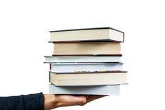 βιβλία που κρατούν το άτο&mu Στοκ φωτογραφία με δικαίωμα ελεύθερης χρήσης