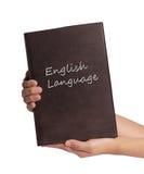 Βιβλίο αγγλικής γλώσσας εκμετάλλευσης χεριών που απομονώνεται στο άσπρο υπόβαθρο Στοκ εικόνες με δικαίωμα ελεύθερης χρήσης