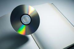 Βιβλίο και δίσκος DVD Στοκ Φωτογραφίες