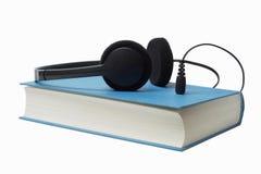 Βιβλίο και ακουστικά στοκ φωτογραφίες