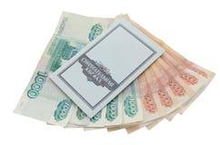 Βιβλίο και χρήματα αποταμίευσης στο άσπρο υπόβαθρο Στοκ Εικόνες