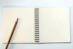 Βιβλίο σημειώσεων και μολύβι Στοκ Φωτογραφία