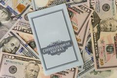 Βιβλιάριο και δολάρια Στοκ Εικόνες