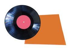Βινυλίου δίσκος με την κόκκινη ετικέτα και την πορτοκαλιά κάλυψη Στοκ Φωτογραφίες
