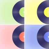 Βινυλίου αρχεία στα χρωματισμένα υπόβαθρα απεικόνιση αποθεμάτων