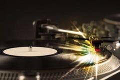 Βινύλιο παιχνιδιού φορέων μουσικής με τις γραμμές πυράκτωσης που προέρχονται από την ανάγκη Στοκ Φωτογραφίες