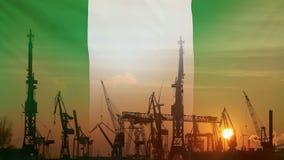 Βιομηχανική έννοια με τη σημαία της Νιγηρίας στο ηλιοβασίλεμα απόθεμα βίντεο