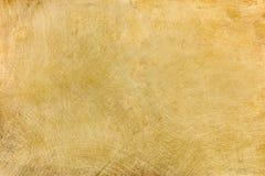 Βιομηχανικό βουρτσισμένο πιάτο ορείχαλκου με τις πολλαπλάσιες γρατσουνιές backgroun στοκ εικόνα με δικαίωμα ελεύθερης χρήσης