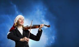 Βιολί παιχνιδιού γυναικών Santa Στοκ Φωτογραφία