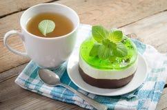 Βοτανικό τσάι με το κέικ Στοκ Εικόνα