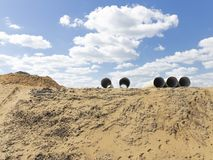 Βουνό άμμου και πέντε σωλήνων στοκ φωτογραφία
