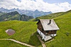 βουνό Ελβετός σπιτιών Στοκ Εικόνες