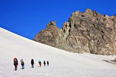 βουνό ορειβατών χιονώδε&sigma Στοκ Φωτογραφίες