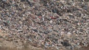 Βουνό των πλαστικών συσκευασιών μπουκαλιών αποβλήτων απορριμάτων των σαπίζοντας τροφίμων φιλμ μικρού μήκους