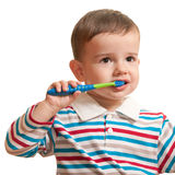 βουρτσίζοντας πρώτα δόντι&a Στοκ Εικόνες