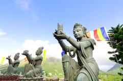 Βουδιστικά αγάλματα Po Lin στο μοναστήρι, νησί Lantau, Χονγκ Κονγκ Στοκ Φωτογραφίες