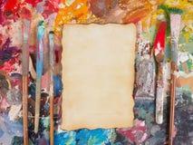 Βούρτσα και έγγραφο για την παλέτα λάδι-χρωμάτων για το υπόβαθρο Στοκ εικόνες με δικαίωμα ελεύθερης χρήσης