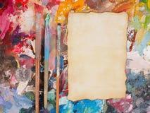 Βούρτσα και έγγραφο για την παλέτα λάδι-χρωμάτων για το υπόβαθρο Στοκ Φωτογραφίες