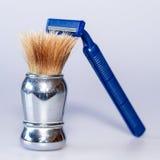Βούρτσα ξυρίσματος ξυριστικών μηχανών Στοκ φωτογραφία με δικαίωμα ελεύθερης χρήσης