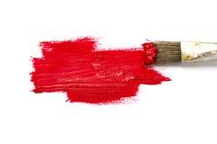 Βούρτσα χρωμάτων με το κτύπημα κόκκινου χρώματος και χρωμάτων στο άσπρο BA Στοκ φωτογραφία με δικαίωμα ελεύθερης χρήσης