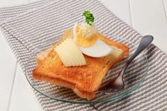 βούτυρο ψωμιού που ψήνετ&alph Στοκ φωτογραφία με δικαίωμα ελεύθερης χρήσης