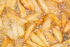 Βράζοντας τηγανιτές πατάτες Στοκ Εικόνα