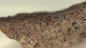 Βράχος λάβας Scoria που απομονώνεται απόθεμα βίντεο