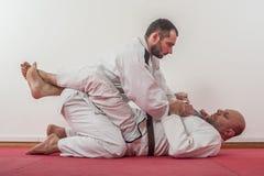 Βραζιλιάνα επίδειξη κατάρτισης jiu-jitsu στο παραδοσιακό κιμονό στοκ φωτογραφίες