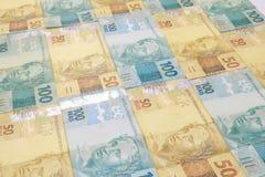 Βραζιλιάνα ανασκόπηση χρημάτων Bill αποκαλούμενοι πραγματικοί Στοκ εικόνες με δικαίωμα ελεύθερης χρήσης