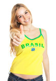 Βραζιλιάνος αθλητικός ανεμιστήρας που παρουσιάζει αντίχειρα Στοκ εικόνα με δικαίωμα ελεύθερης χρήσης