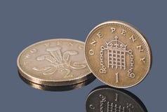 Βρετανικά νομίσματα χαλκού στο σκοτεινό υπόβαθρο Στοκ Εικόνα