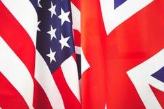Βρετανική σημαία και ΑΜΕΡΙΚΑΝΙΚΗ σημαία Σχέσεις μεταξύ των χωρών τονισμός Στοκ Εικόνα