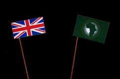 Βρετανική σημαία με την αφρικανική σημαία ένωσης στο Μαύρο Στοκ φωτογραφία με δικαίωμα ελεύθερης χρήσης