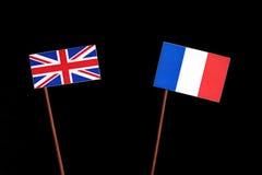 Βρετανική σημαία με τη γαλλική σημαία στο Μαύρο Στοκ Εικόνες