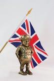 Βρετανική σημαία με τον αριθμό του John Bull ως τράπεζα ορείχαλκου Στοκ Φωτογραφία
