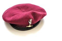 Βρετανικό καφέ αερομεταφερόμενο και roal beret σημάτων Στοκ Φωτογραφίες