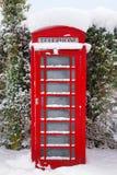 βρετανικό κόκκινο χιόνι phonebox στοκ φωτογραφία με δικαίωμα ελεύθερης χρήσης