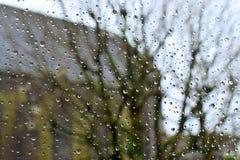 Βροχή στο γυαλί από το παράθυρο Στοκ Εικόνες