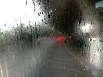 Βροχερός στο παράθυρο στοκ φωτογραφία